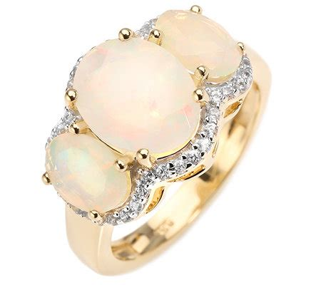 Opal 2 12ct afrikanischer opal 2 12ct trilogie ring zircon 0 23ct gold