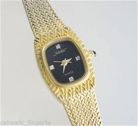 xavier masterpiece s gold tone mesh black