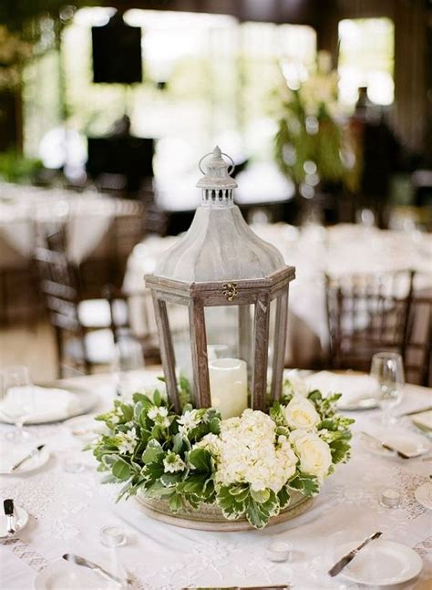 wedding centerpieces with flowers and lanterns wood lantern and white flowers wedding centerpiece deer