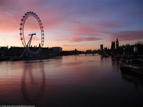 london eye themes london eye and houses of parliament just before sunrise