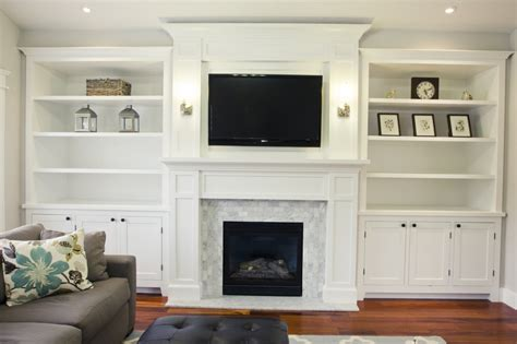 fireplace built ins on bookshelves around