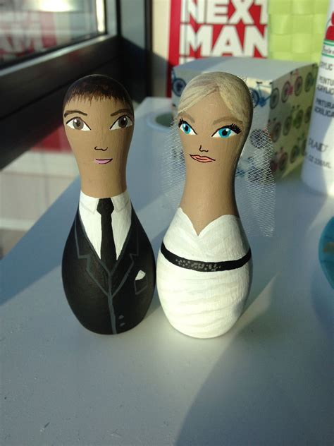 bowling pin shaped wedding cake toppers i painted for bowling themed wedding ideas