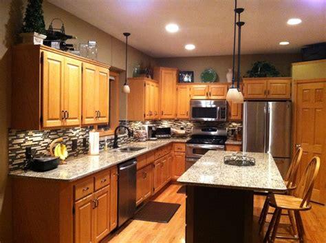delta chagne bronze cabinet hardware after photo santa cecilia granite countertops oil rubbed
