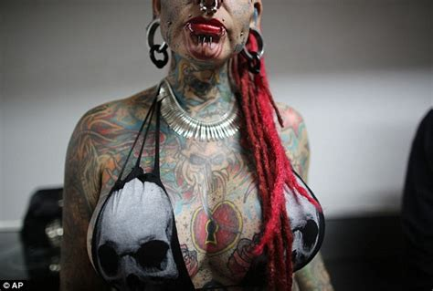 tattoo extreme expo piercings tats and even devil horns out in force at the