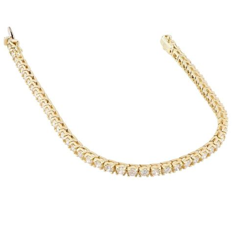 5 carat yellow gold prong set tennis bracelet for