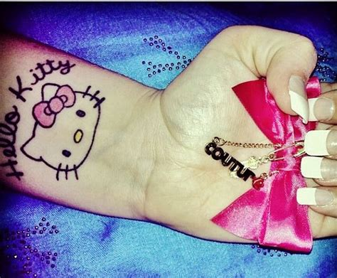 hello kitty tattoo on wrist hello wrist with bow pink bow couture