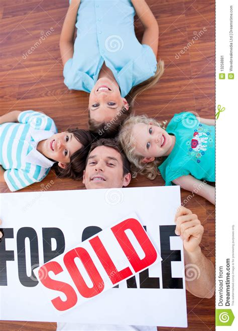 after buying a house happy family lying on floor after buying a house stock image image 13258881