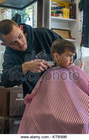 2 year boy haircut barber cutting boy s hair stock photo royalty free image