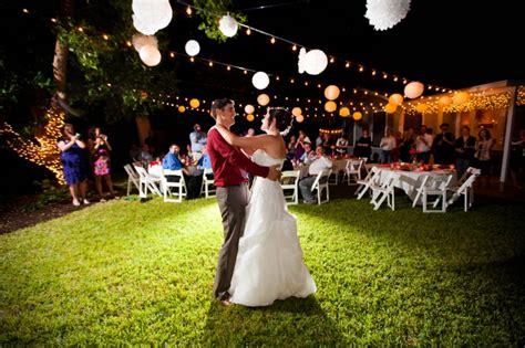 Backyard Wedding Lanterns 06 And Groom On Grass Inder Paper Lanterns