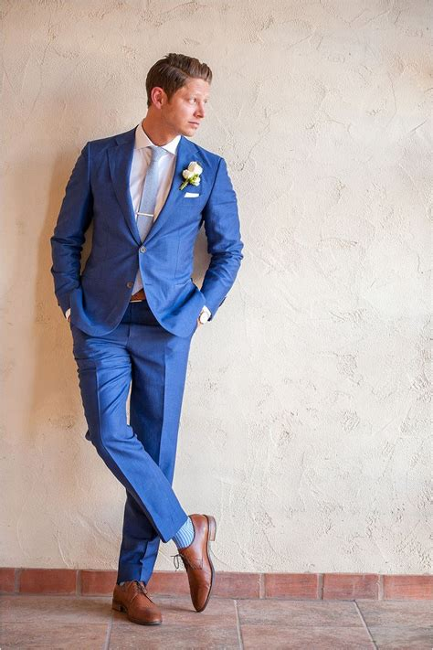 Wearing A Royal Blue Suit For Wedding My Wedding Ideas | dapper groom in royal blue suit with saddle color shoes
