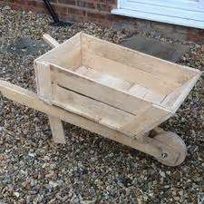 Wheelbarrow Planter Box by How To Build A Planter Box Wheelbarrow 14 Steps With