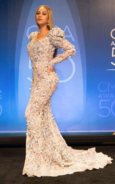 beyonc 233 wore two embellished gowns to the cma awards