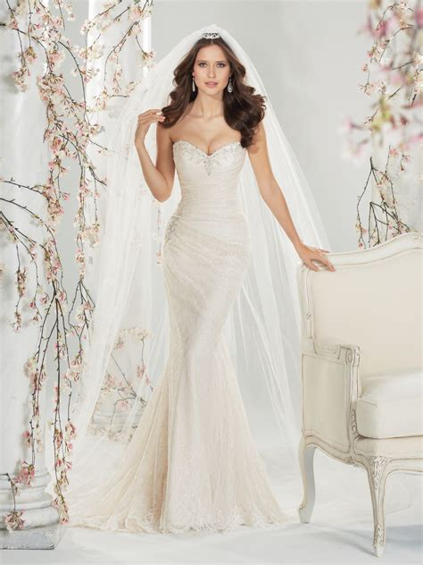 a line wedding gown with sweep train