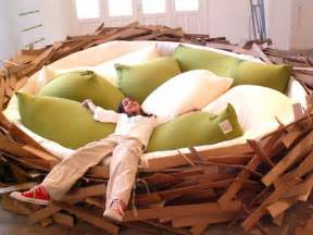 The giant birds nest is literally a gigantic and comfortable looking