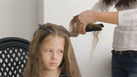 getting her barbered braiding hair stock footage video 5744018 shutterstock