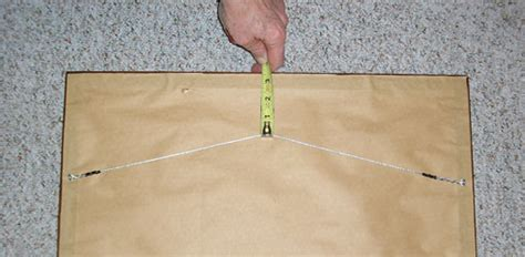 hang a picture how to hang pictures right the first time today s homeowner