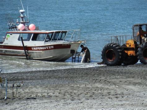boat anchor helper skidder pulling the boat on the trailer out of the water