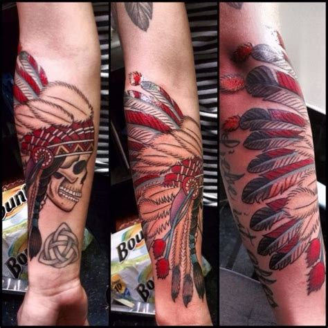 feathers native american headress and skull sleeve tattoos