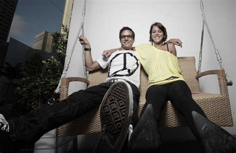 young swinging couple young couple swinging on a bench stock photography image