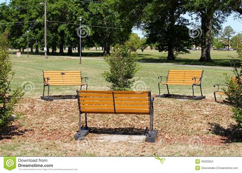 city park bench park benches in a grassy field on a sunny day stock photo image 40333254