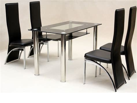 small glass dining table   faux chairs  black