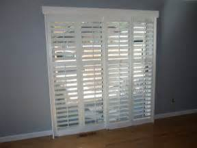 Shutters For Sliding Glass Patio Doors Traditional White Wooden Frame Plantation Shutters For Sliding Glass Patio Door Placed On Gray