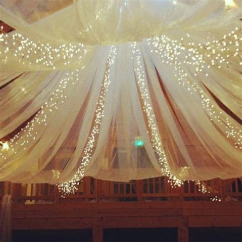 barn wedding tulle and string lights in the barn