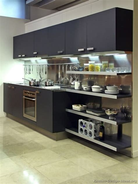 a modern black kitchen with a stainless steel backsplash