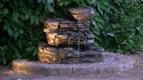 infinity hampton bay oasis rock fountain  night