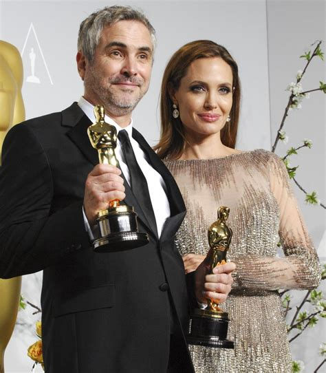 alfonso cuaron on how angelina jolie and robert downey jr angelina jolie picture 414 the 86th annual oscars