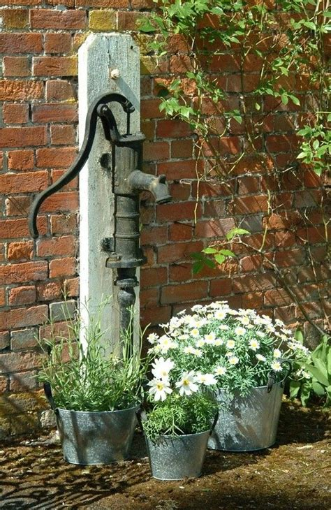 backyard water pump flower garden and vintage water pump
