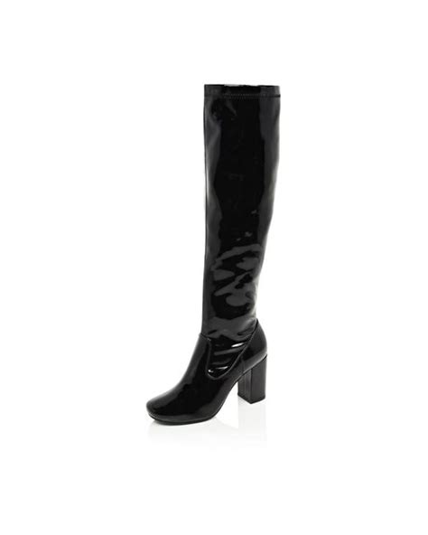 river island black patent knee high heeled boots in black