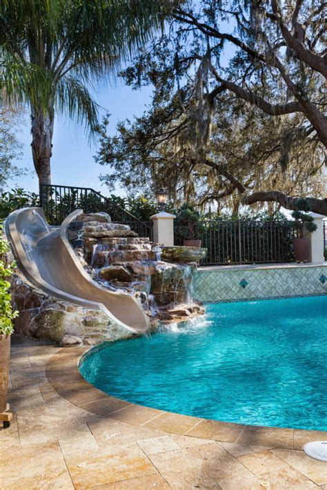 garden swimming pools with slides photo pixelmari