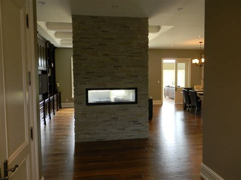 rijus home design inc double sided gas fireplace in bungalow entry toronto by rijus home design inc