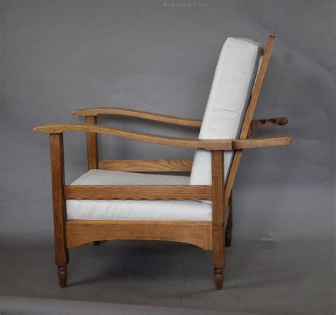 oak armchair pair of oak reclining armchairs in the manner of heals