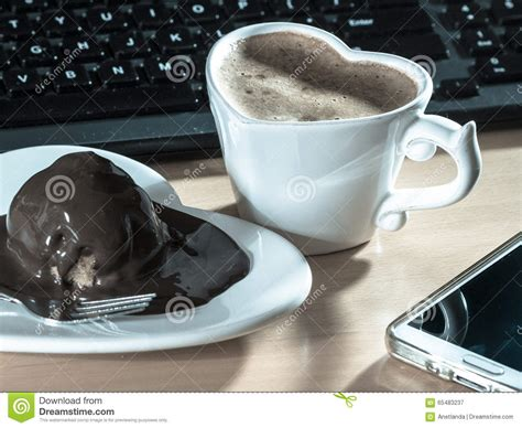 Links From Chocolate Keyboards To Espresso by Cup Of Coffee Next To Laptop Stock Photography