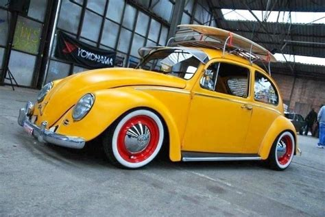 volkswagen bug yellow yellow beetle with red rims beetle vw bug dream cars
