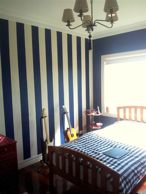 blue striped walls stripes in navy on one wall behind headboard charmaine s