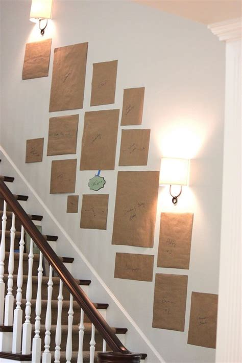 what to use to put pictures on wall how to arrange a picture display use craft paper to trace