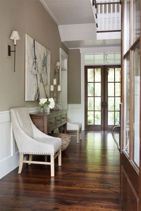 wood floors and light accents the beige taupe wall is the neutral color for any