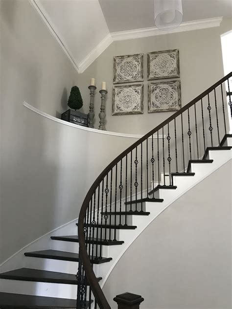 decorate large high ceiling curved stairs shelf large
