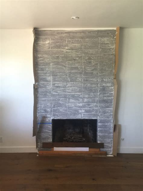 From white brick to grey stucco: our fireplace's
