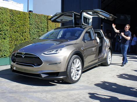 How Much A Tesla Car Cost Tesla S Car For The Masses The Model E To Be Released