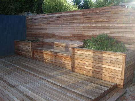 garden bench made from decking timber seating area with matching decking and raised