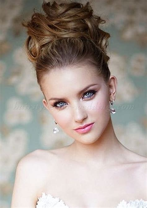 young bridesmaid buns brides with high updos high bun wedding hairstyle
