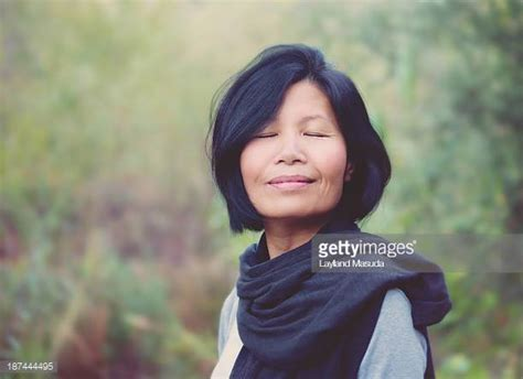 50 year asian women asian 50 to 55 years old woman stock photos and pictures