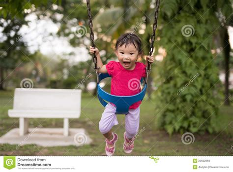 swing for 2 year old asian chinese two year old girl on a swing in the
