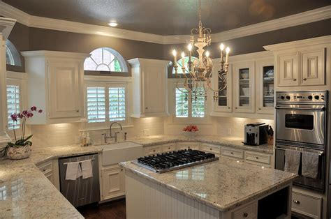 Beautiful u shaped kitchen with dark taupe walls and ceiling and