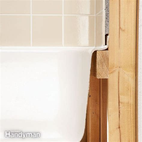 installing tile around bathtub tile installation backer board around a bathtub the family handyman