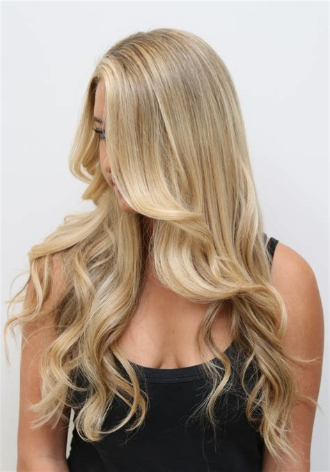 Extravagant long blonde hair hair color rehab